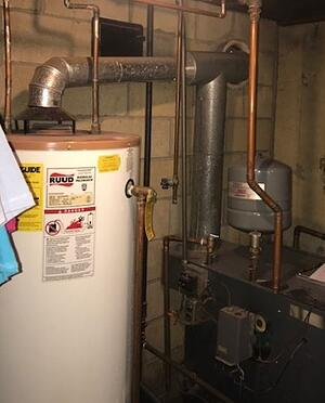 An old boiler is replaced by a smaller high-efficiency unit in Easton, PA